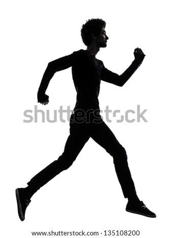 one african handsome young man running  in silhouette studio isolated on white background - stock photo