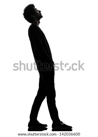 one african handsome young man standing looking up surprise   in silhouette studio isolated on white background - stock photo