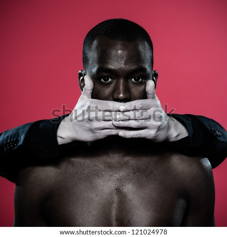 one african man hand on his mouth Freedom of speech concept - stock photo