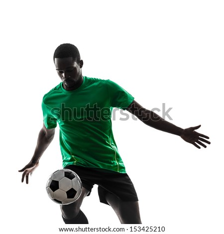 one african man soccer player green jersey juggling in silhouette  on white background - stock photo