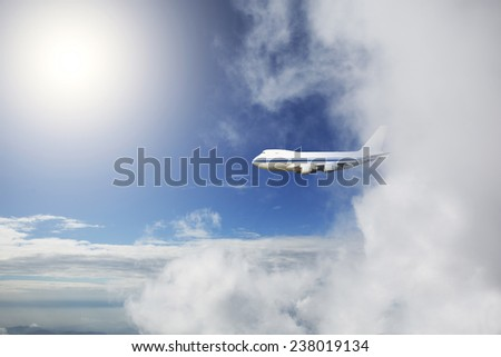One Aircraft flying out of cloud - stock photo