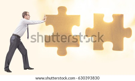one alone Business concept image photo of a businessman pushing the final piece of puzzle. full length businessman