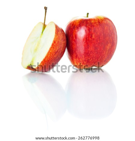 One and a half of red apple photographed on glass surface with reflection isolated on white background  - stock photo