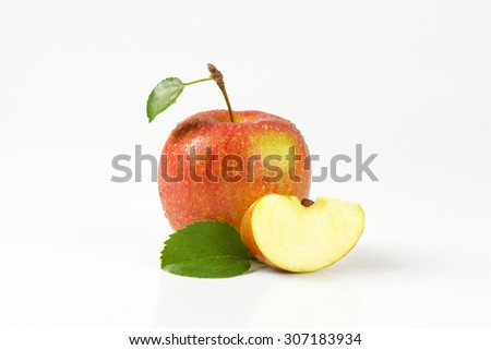 one and a quarter washed apples on white background