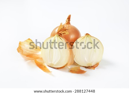 one and two halves raw onion on white background - stock photo