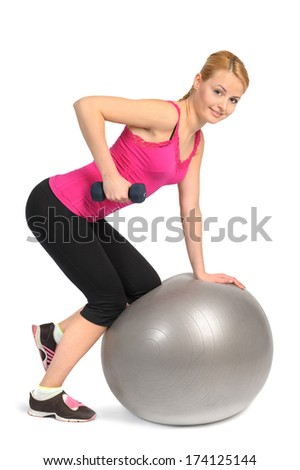 One-Arm Dumbbell Row or Raw on Stability Fitness Ball Exercise, phase 1 of 2 - stock photo