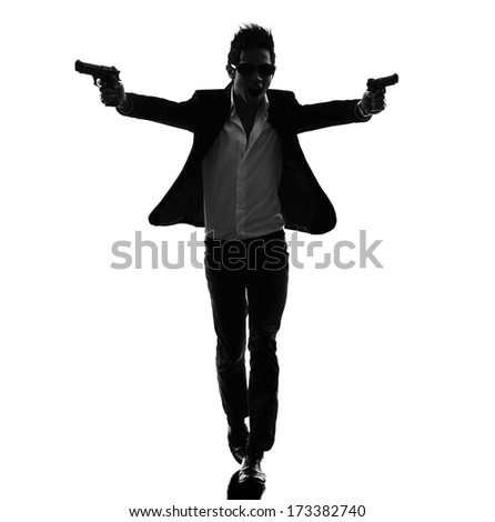 one asian gunman killer  in silhouette isolated white background - stock photo