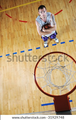 one basket ball game player standing in sport gym with ball - stock photo