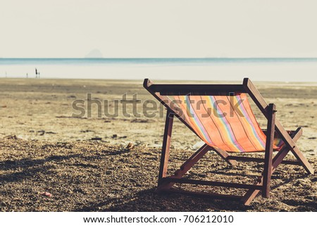 One Beach Chairs with sunset light single summer travel holiday concept vintage color tone