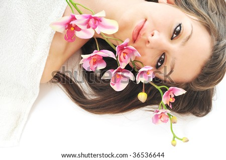 one  beautiful young  woman face with flower and towel