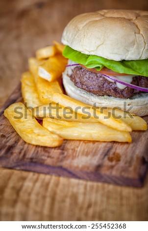One beef burger in a bun taken in studio - stock photo