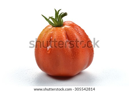 One Beefsteak Tomato with Drops on white board