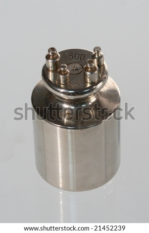 one big and four small weights - stock photo