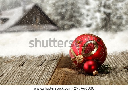 one big and one snall red ball on gray wooden top  - stock photo