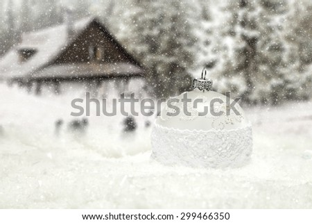 one big ball on snow and blurred background of farm  - stock photo