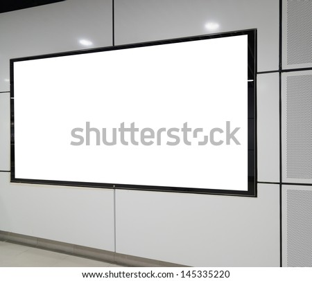 One big horizontal / landscape orientation blank billboard on white wall - stock photo