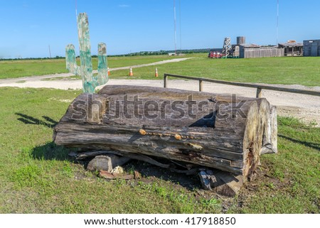 one big log with a carved in bench - stock photo