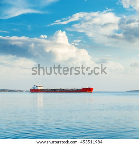 one big ship in river and blue sky with clouds - stock photo