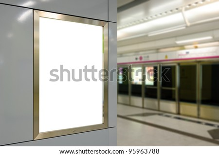 One big vertical / portrait orientation blank billboard on modern white wall with subway platform background