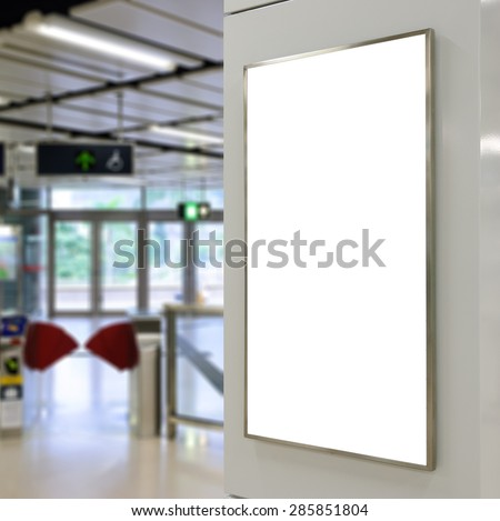 One big vertical / portrait orientation blank billboard with entrance of railway station background - stock photo