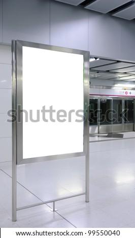 One big vertical / portrait orientation blank billboard with train platform background - stock photo