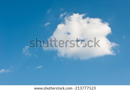 One big white cloud in blue sky