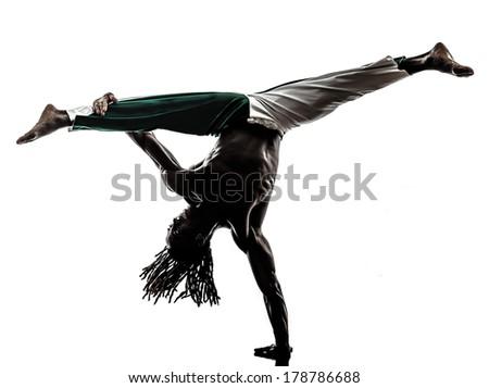 one black man dancer dancing capoeira on white background - stock photo