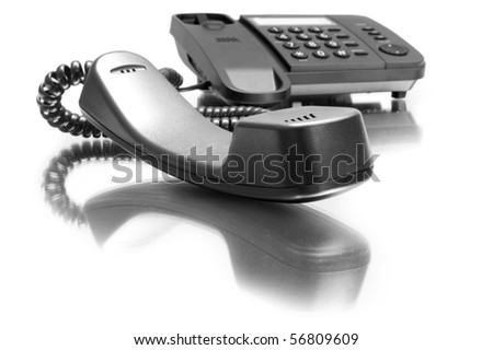 One black phone with mirror reflexion on white background - stock photo