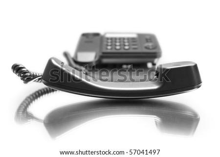 One black phone with mirror reflexion on white background - stock photo