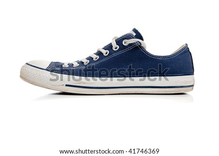 One blue tennis shoe on a white background