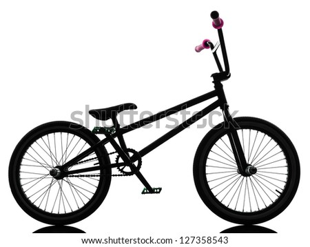 one bmx bicycle  in silhouette studio isolated on white background
