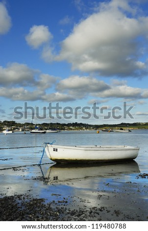 One boat with Cornish flag. Padstow, view to Rock mariner. - stock photo