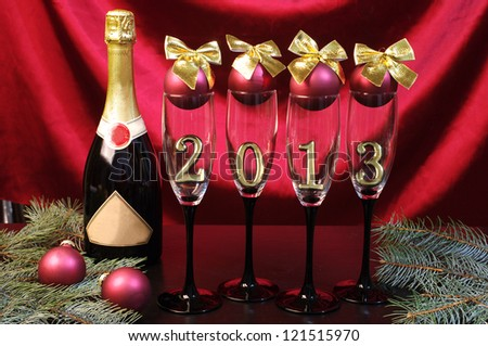 One bottle of champagne and  Four  goblets of champagne with numeral 2013 against purple drapery. Happy New Year! - stock photo