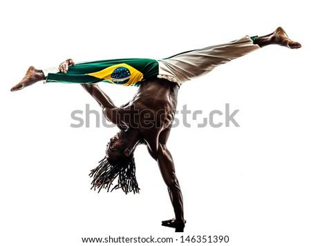 one brazilian  black man dancer dancing capoiera on white background - stock photo