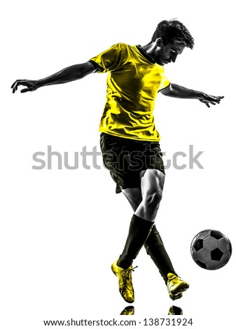 one brazilian soccer football player young man dribbling in silhouette studio isolated on white background - stock photo