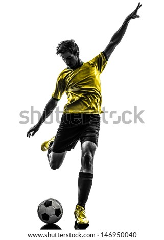 one brazilian soccer football player young man kicking in silhouette studio  on white background - stock photo