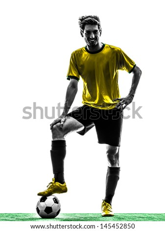 one brazilian soccer football player young man standing in silhouette studio  on white background - stock photo
