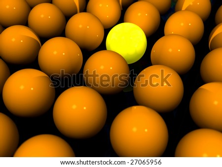 One bright yellow ball in a group of orange balls. - stock photo