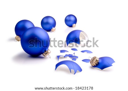 One broken blue Christmas Tree ornament and four intact on a field of white. - stock photo
