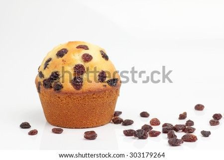 one brown muffin bakery on white background raisin - stock photo