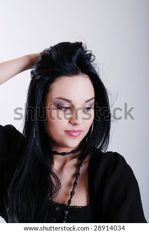 one brunette woman posing in studio