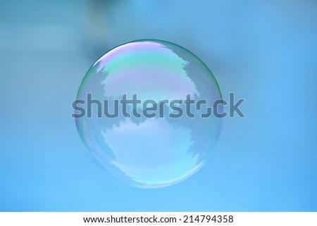 one bubble on blue background - stock photo
