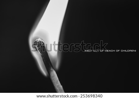 One burning match on black background, warning, PSAs - stock photo