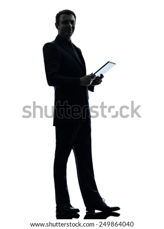 one  business man holding digital tablet posing in silhouette on white background - stock photo