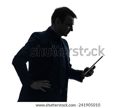 one  business man holding digital tablet smiling in silhouette on white background - stock photo