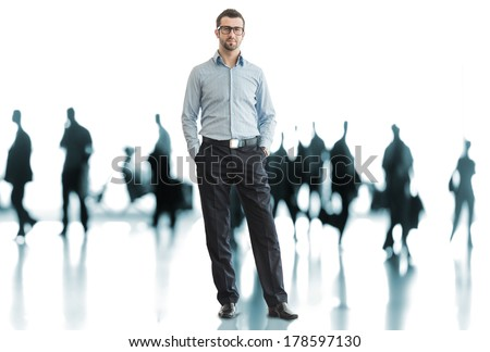 One business man standing in front of crowd - stock photo