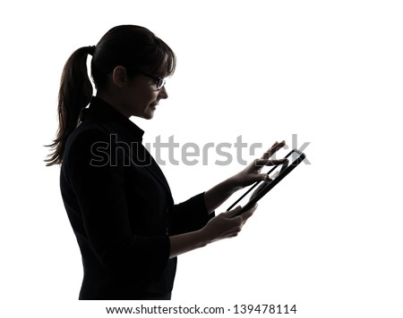 one business woman computer computing typing digital tablet  silhouette studio isolated on white background - stock photo