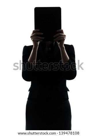 one business woman hiding computer computing digital tablet  silhouette studio isolated on white background - stock photo
