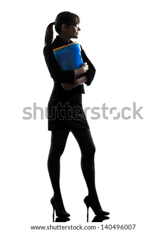 one business woman holding folders files standing  silhouette studio isolated on white background
