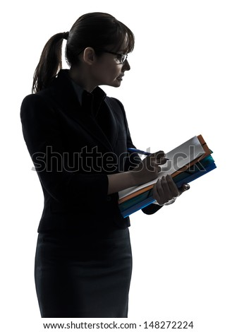 one business woman holding folders files writing  silhouette studio isolated on white background